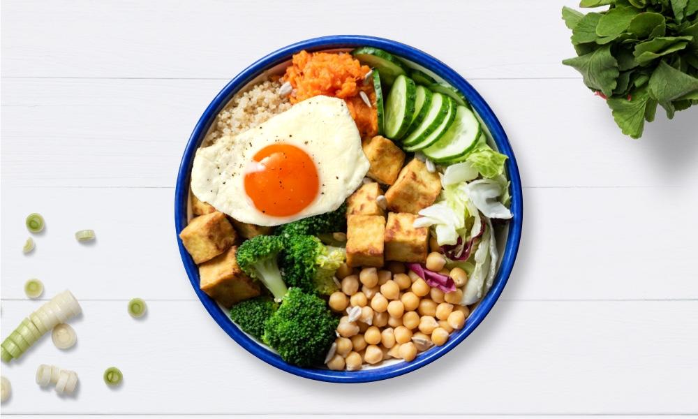 Sesame tofu quinoa bowl with fried egg