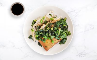 Vegetable dumplings with tofu steak & sautéed kale