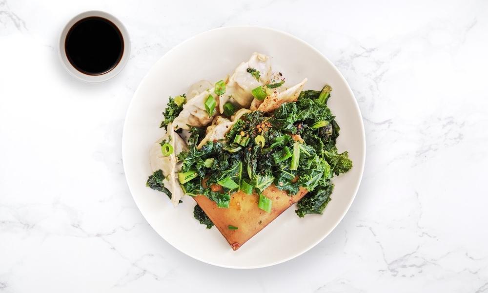 Vegetable dumplings with tofu steak & sautéed kale